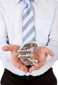 Macro businessman holding a silver mental euro sign — Stock Photo