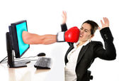 Woman with computer hit by boxing glove social media cyber mobbing — Stock Photo