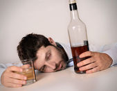 Drunk business man wasted and whiskey bottle in alcoholism — Stockfoto