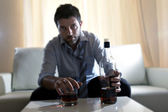 Drunk business man wasted and whiskey bottle in alcoholism — ストック写真