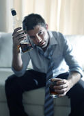 Drunk business man wasted and whiskey bottle in alcoholism — Stock Photo
