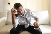 Drunk business man wasted and whiskey bottle in alcoholism — Foto Stock