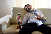 Drunk business man wasted and whiskey bottle in alcoholism — Photo