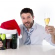 Drunk businessman asleep after drinking to much at his xmas part — Stock Photo #49904927