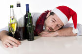 Drunk businessman asleep after drinking to much at his xmas part — Stock Photo