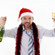 Businessman drinking champagne wearing a santa hat on white back — Stock Photo #49958081