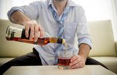 Businessman wearing blue shirt drunk at desk on white background — Stock Photo