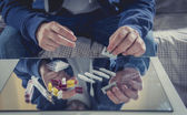 Young drug addict man on hood sniffing cocaine on mirror — Stock Photo