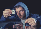 Depressed sick looking Cocaine addict man sniffing coke — Stock Photo