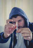 Drug addict getting heroin syringe ready to inject the the drug — Foto Stock