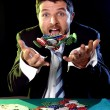 Happy man throwing to the air poker chips after winning bet gambling — Stock Photo