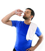 Young attractive and athletic sport man drinking water — Stock Photo