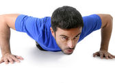 Attractive sport man training push up exercise isolated on white background — Stock Photo