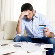 Latin business man worried paying bills on couch — Stock Photo #51590939