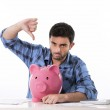 Sad worried man in stress with piggy bank in bad financial situation — Stock Photo #51695907