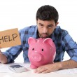 Sad worried man in stress with piggy bank in bad financial situation — Stock Photo #51695961