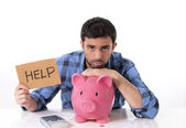 Sad worried man in stress with piggy bank in bad financial situation — Stock Photo