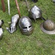 Medieval knights helmets and gloves — Stock Photo #30346971