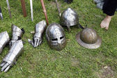 Medieval knights helmets and gloves — Stock Photo