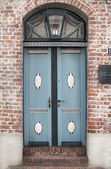 Vintage style country door in blue — Stock Photo