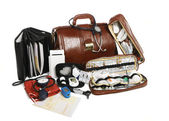 Doctors brown leather bag with stethoscope and other medical equ — Stock Photo