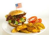 Burger with potato wedges — Stock Photo