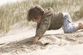 Boy playing in the sand — Stock Photo