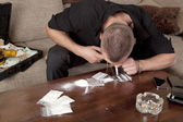 Man taking a line cocaine — Stock Photo