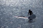 Kitesurfer stands in water — Стоковое фото