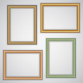 Vector set of realistic plastic portrait frames on the wall — Vector de stock