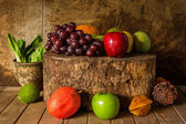 Still life with on the timber full of fruit — Stock Photo