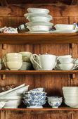 Crockery in the wood larder — Stock Photo