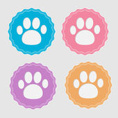 Set of four labels with paw print. — Stockvektor