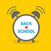 Alarm clock with chalk text Back to school — Stockvektor