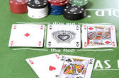 Full aces and king in poker — Stock Photo