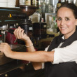 Pretty waitress preparing a coffee — Stock Photo