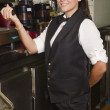 Young waitress in cafe — Stock Photo #33584067