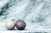 Silver Christmas background with silver ornaments — Stock Photo