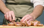 Chef cutting steaks — Stock Photo