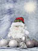Santa claus with christmas ornaments silver — Stock Photo