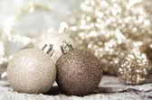 Christmas ornaments of gold and silver — Stock Photo