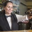 Waitress serving red wine — Stock Photo #35834243