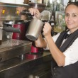 Waitress using coffee machines — Stock Photo