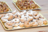 Tray with sugary donuts with pestiños background — Stock Photo