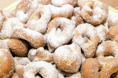 Doughnuts dusted with sugar — Stock Photo