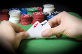 HANDS with pocket aces — Stock Photo