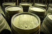 Old barrels in winery viewed from below — Stock Photo