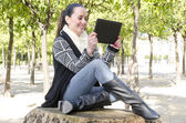 Woman using a tablet — Stock Photo