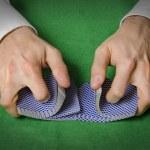 Hands shuffling cards in casino — Stockfoto