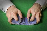 Hands shuffling cards in casino — Stock Photo